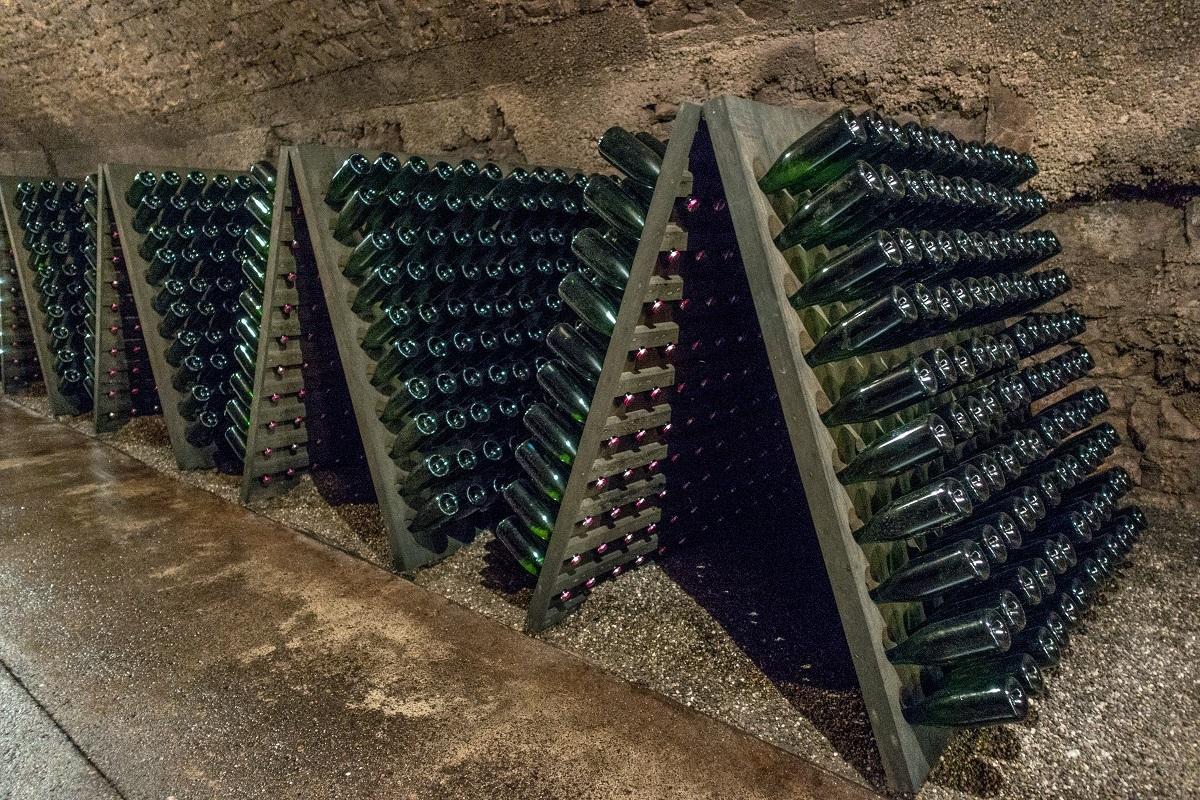 Wine aging in bottles in wine cellar