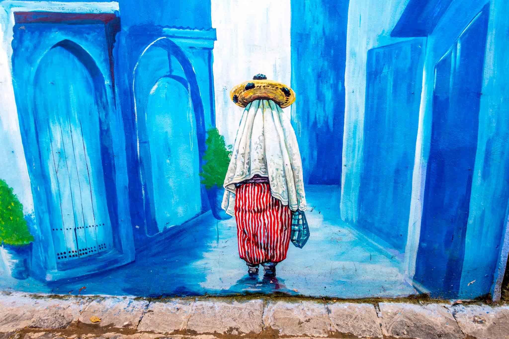 Street art mural of veiled woman