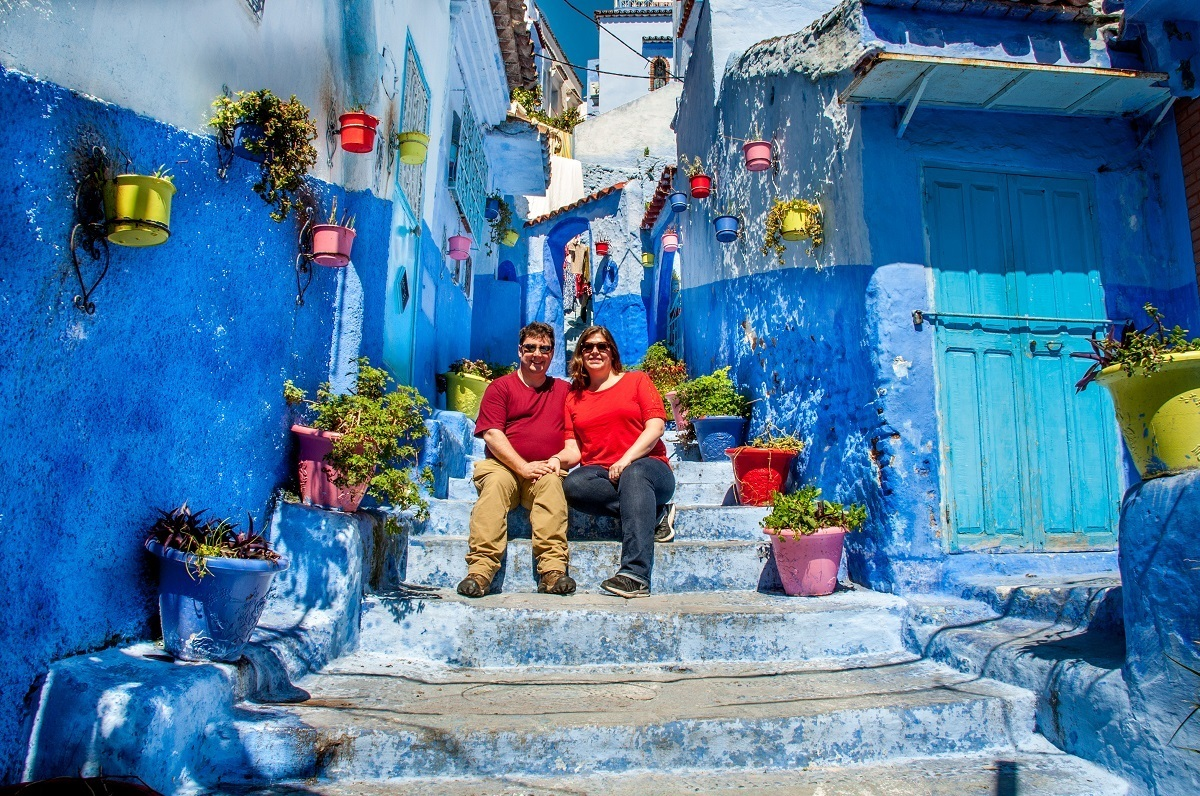 Two people sitting on blue steps