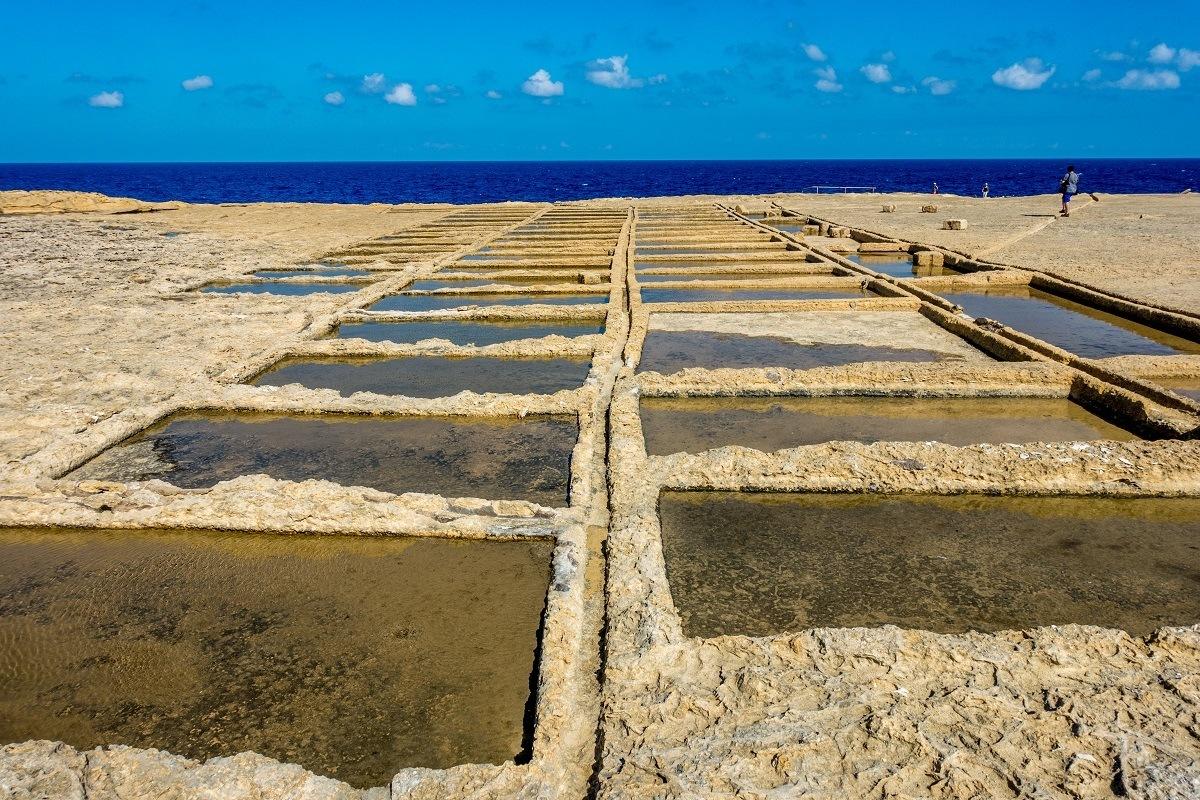 Open air salt pans by the ocean in Gozo