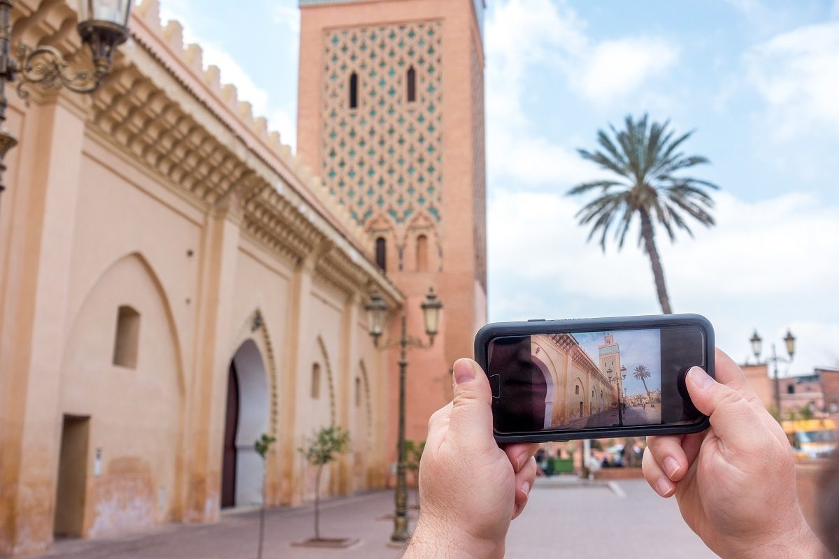 Taking an iPhone photo at the Marrakech Kasbah mosque using a travel wifi device.A internatTional travel wifi device, like ROAMING MAN, allowed us to post directly to our social media accounts. The additional access to information and sense of security were additional benefits.