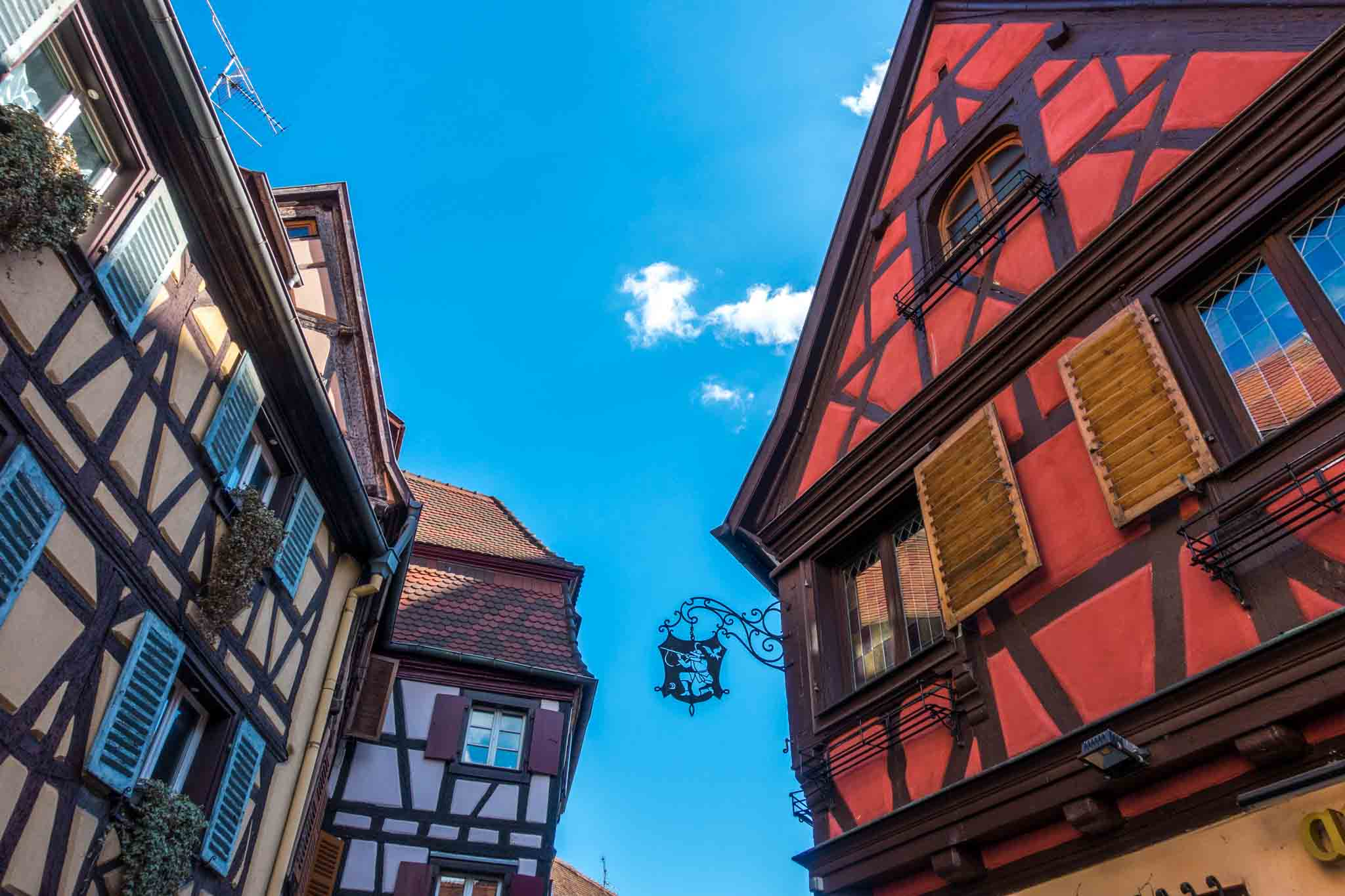 Half-timbered buildings with an iron sign