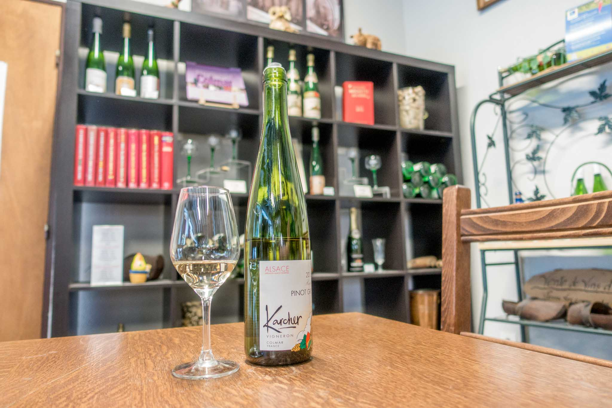 Wine bottle and glass at Domaine Karcher in Alsace France