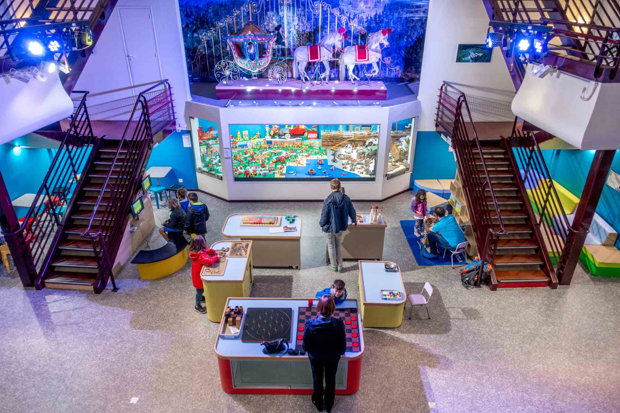 Families playing games inside the Toy Museum