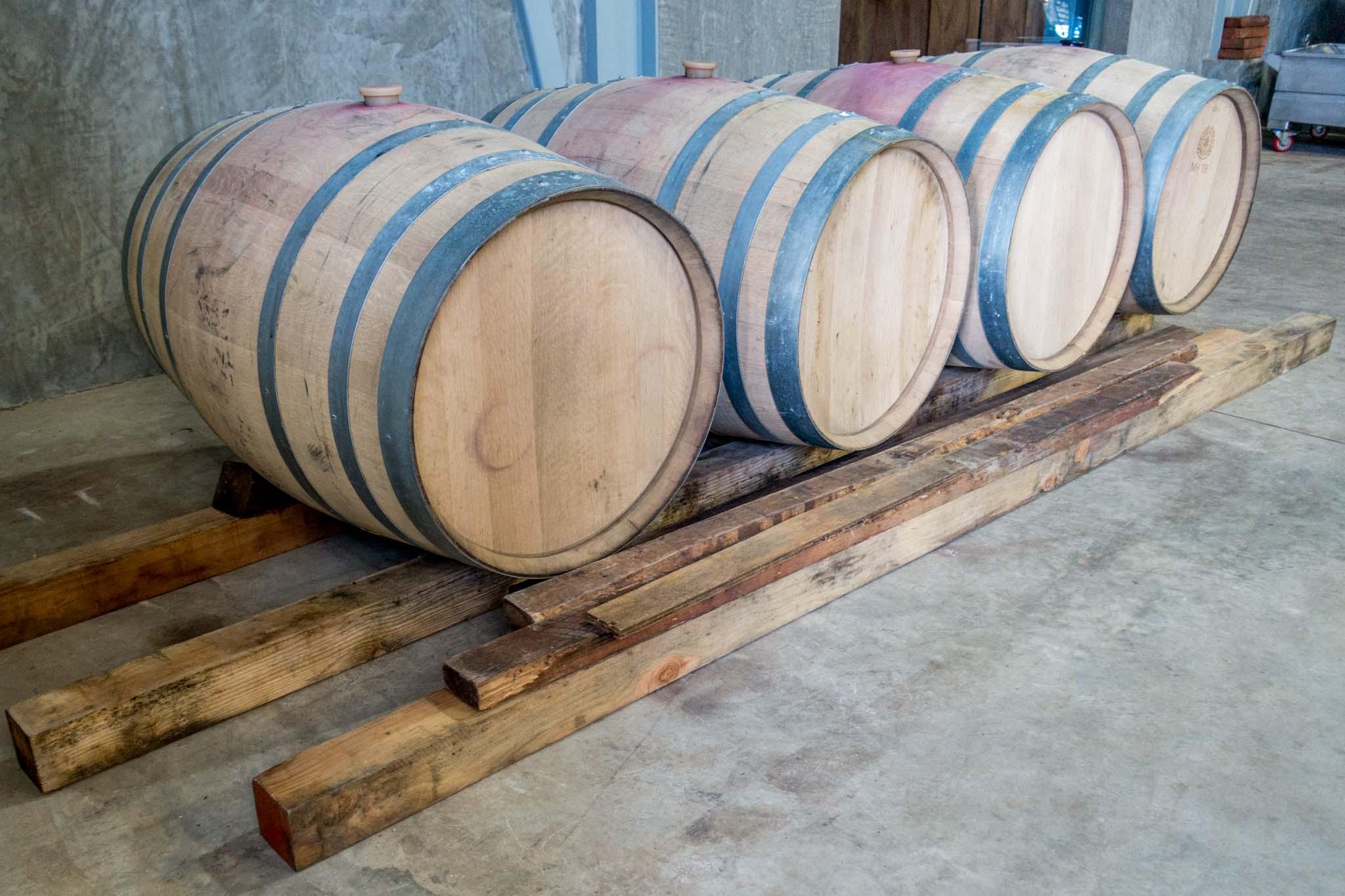 Oak aging barrels at a winery