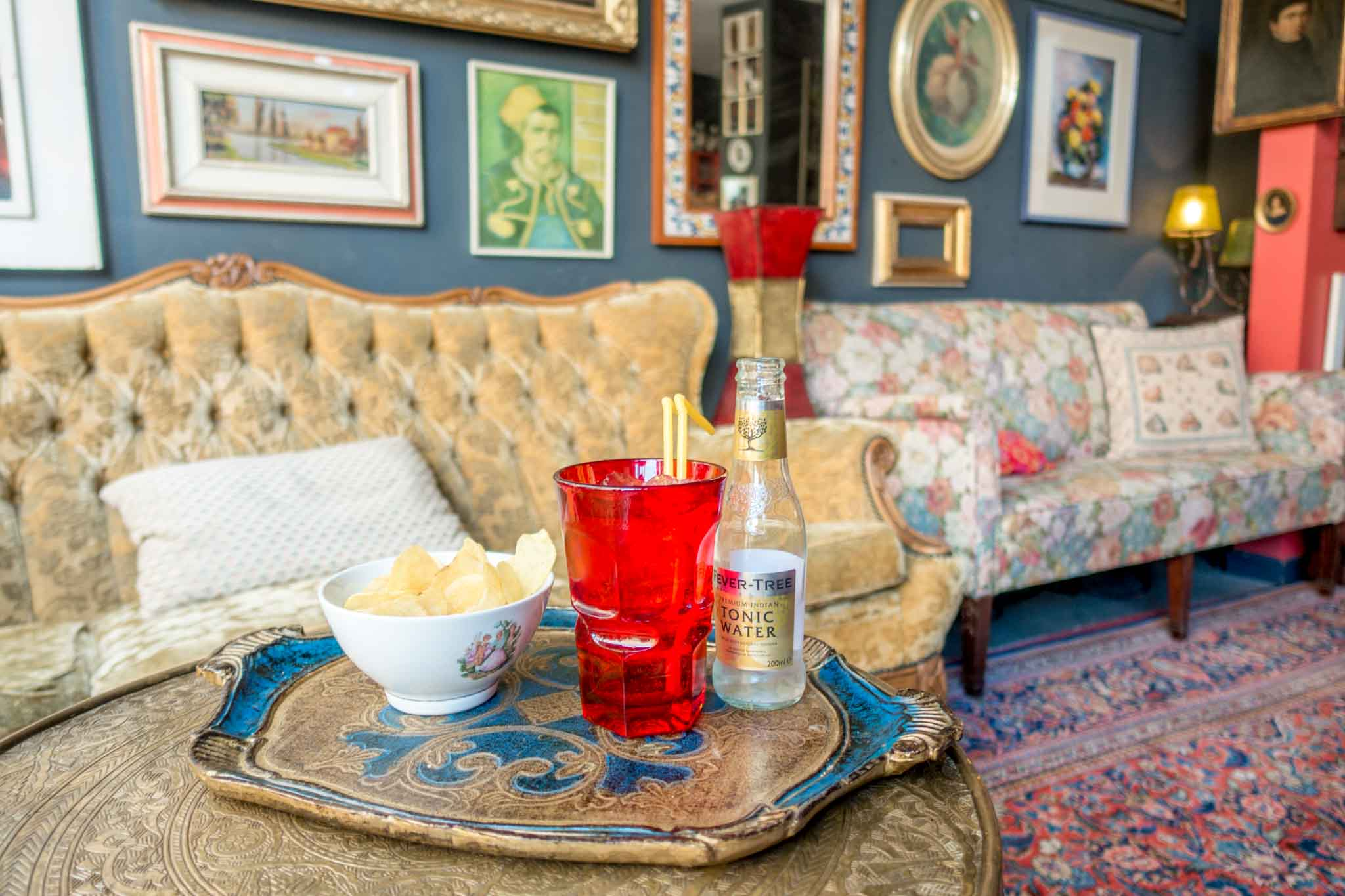 Cocktail and snacks in cafe with vintage furniture