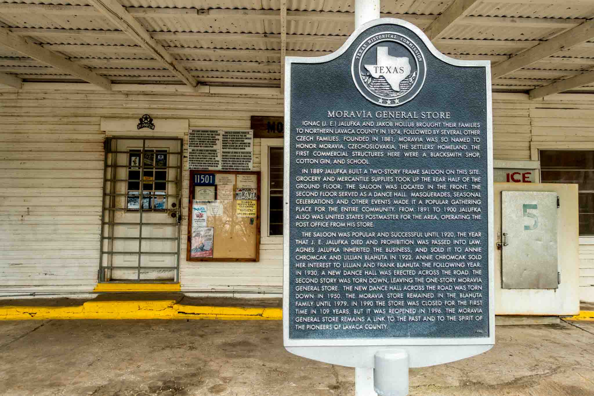 Historical marker for the Moravia general store outside the store