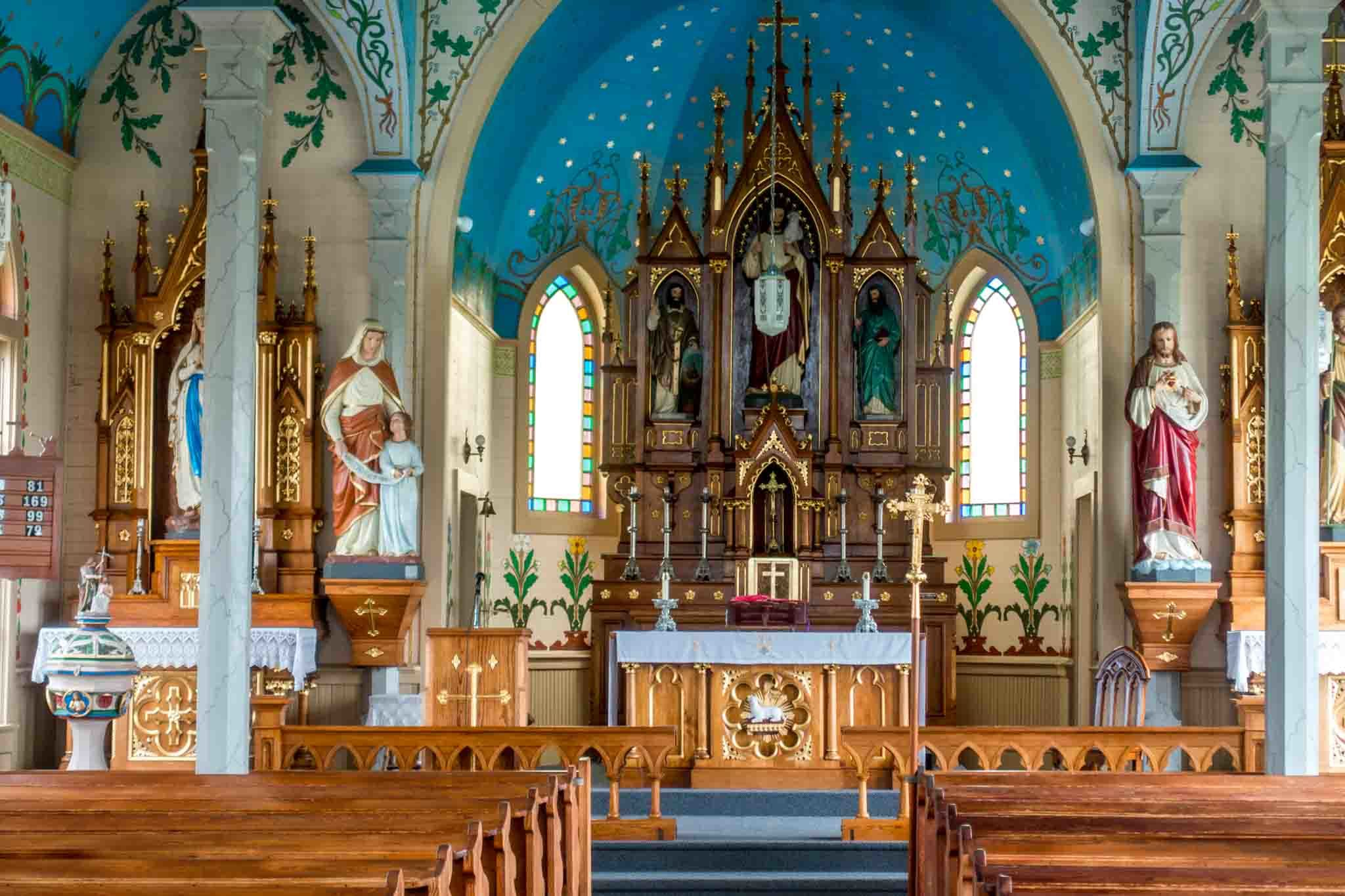 Brightly-painted sanctuary with altar and religious statues