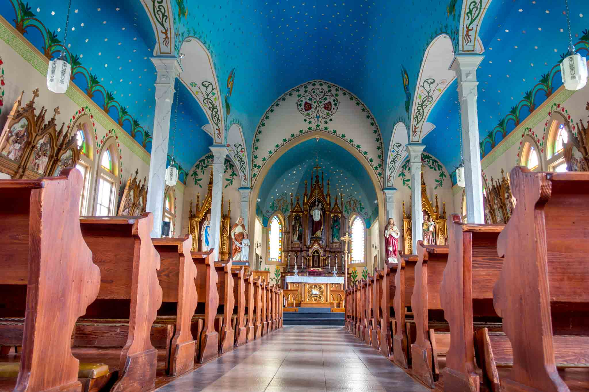Sanctuary interior with blue sky at one of the painted churches of Texas