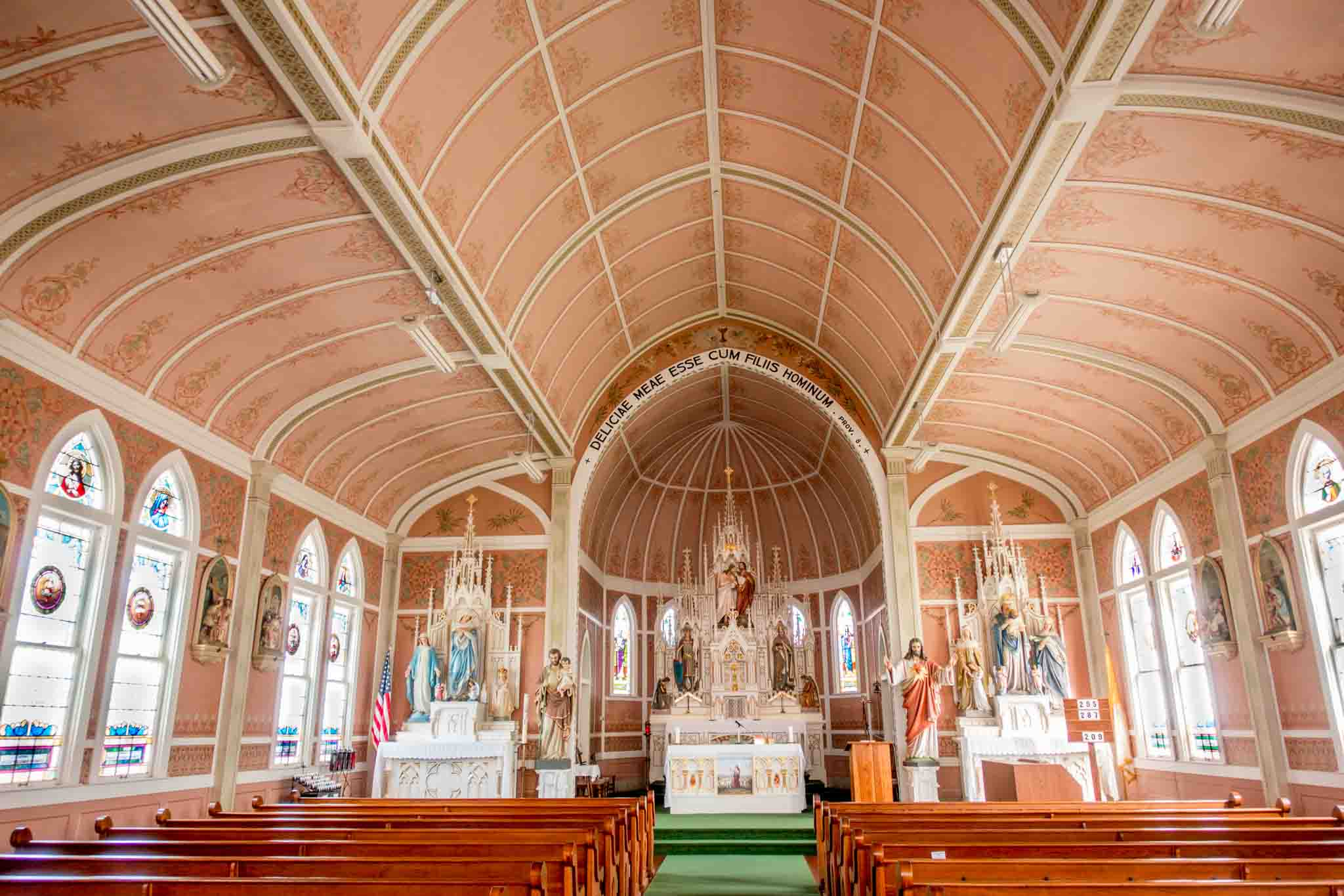 Pink sanctuary of St. John the Baptist with religious statues