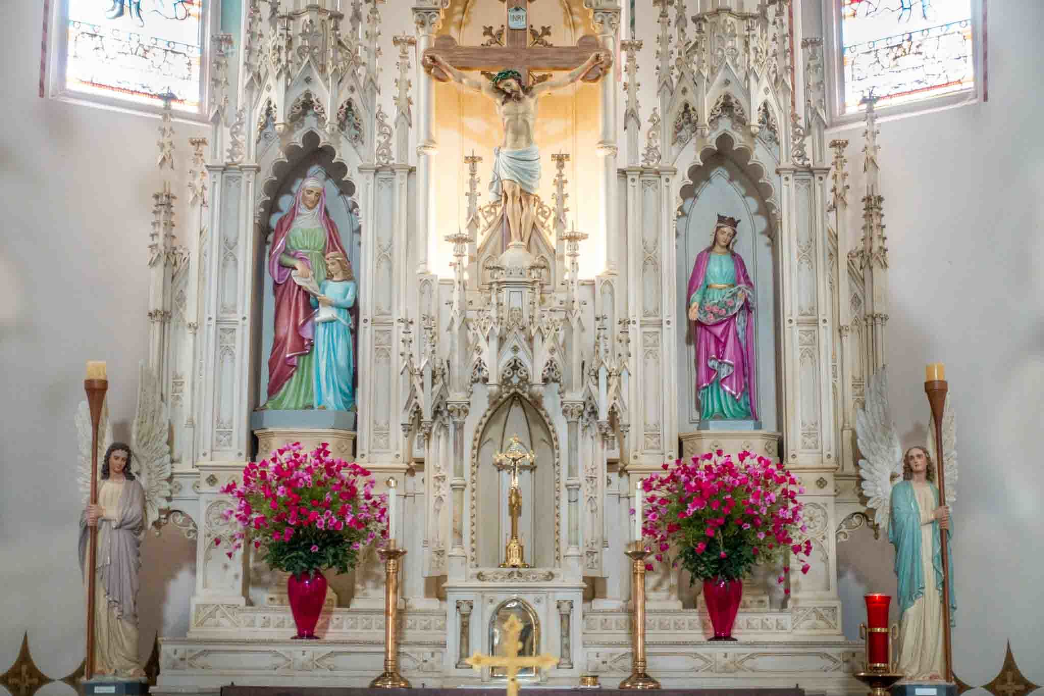 White altar with brightly-colored statues