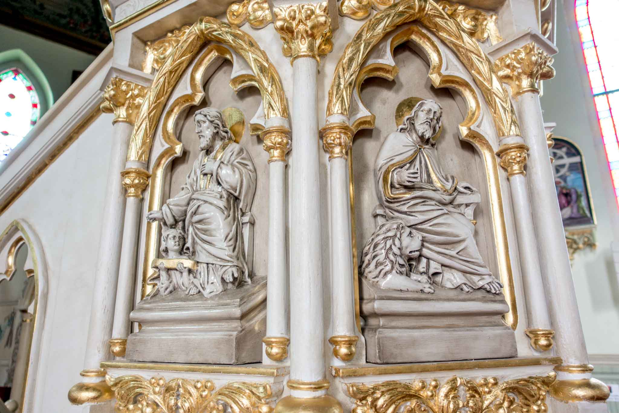Statues on the base of a pulpit