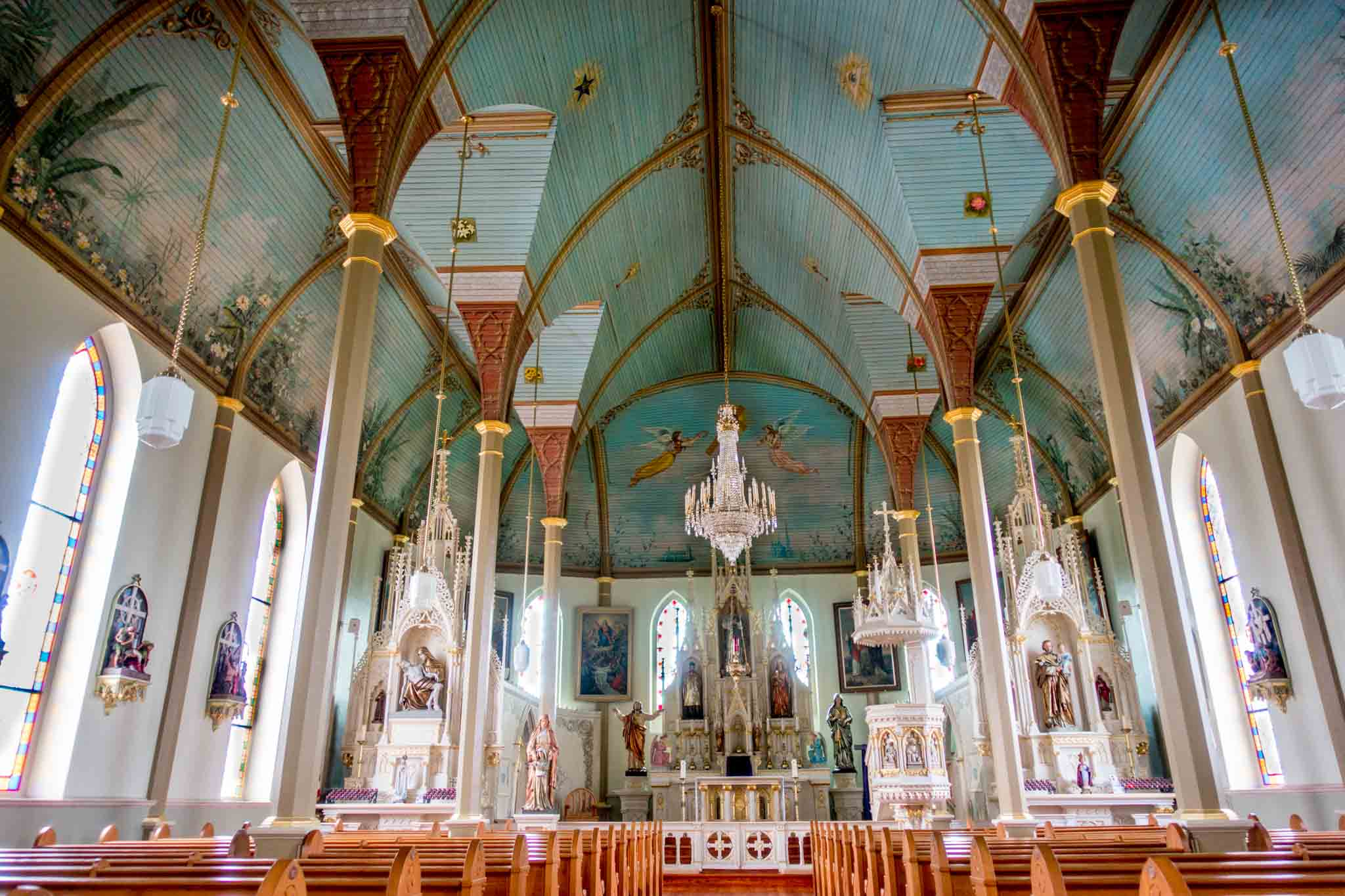 Sanctuary with blue ceiling and chandeliers