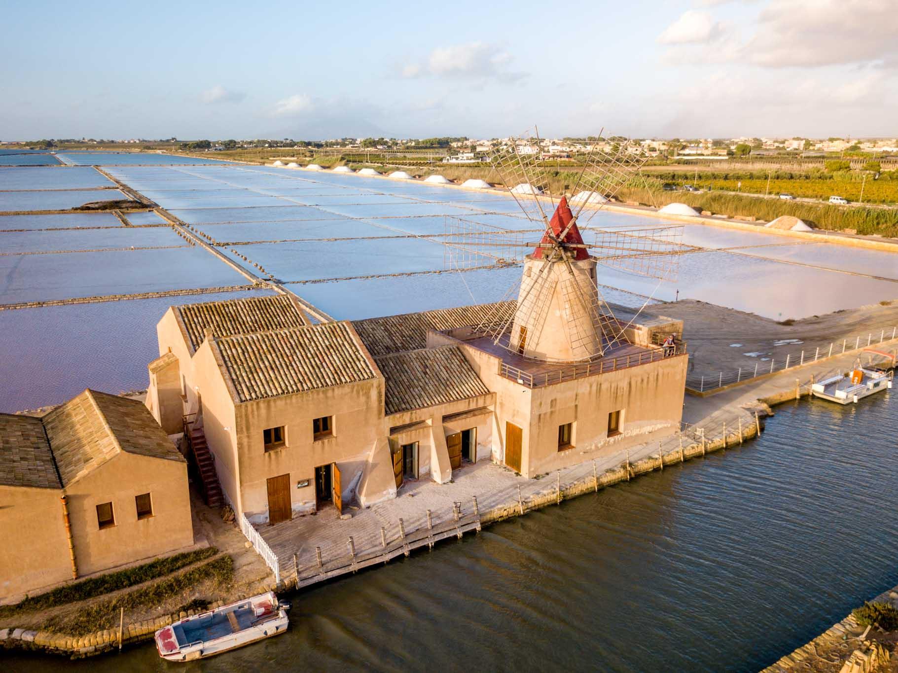 Overhead view of salt flats and a salt mill