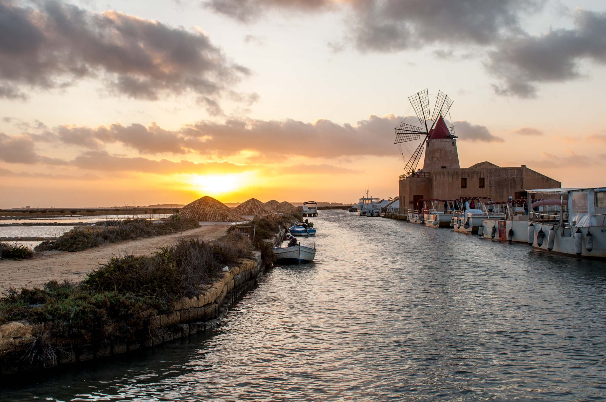 Salt mill and sea at sunset
