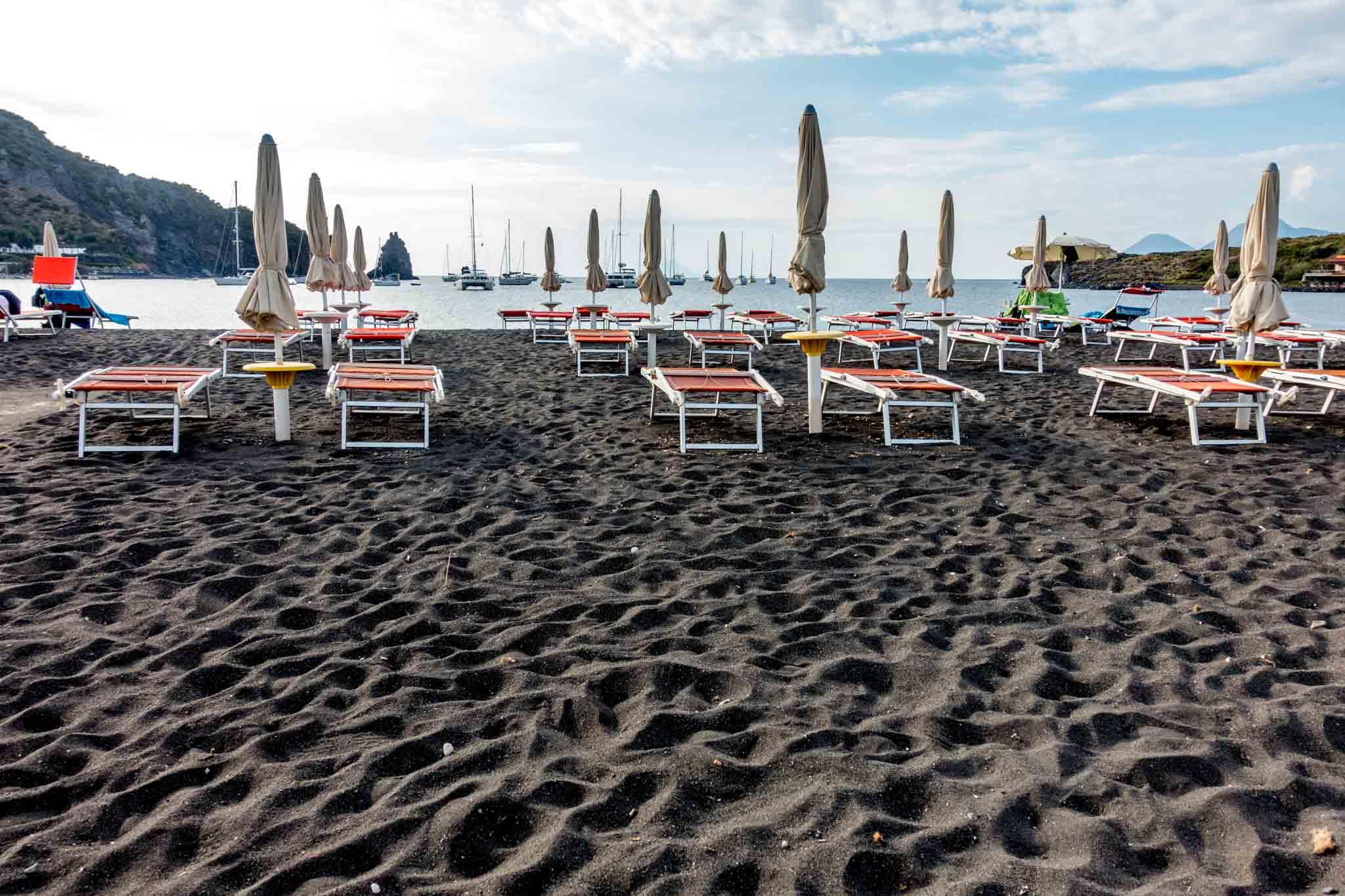 Chairs on black sand beach