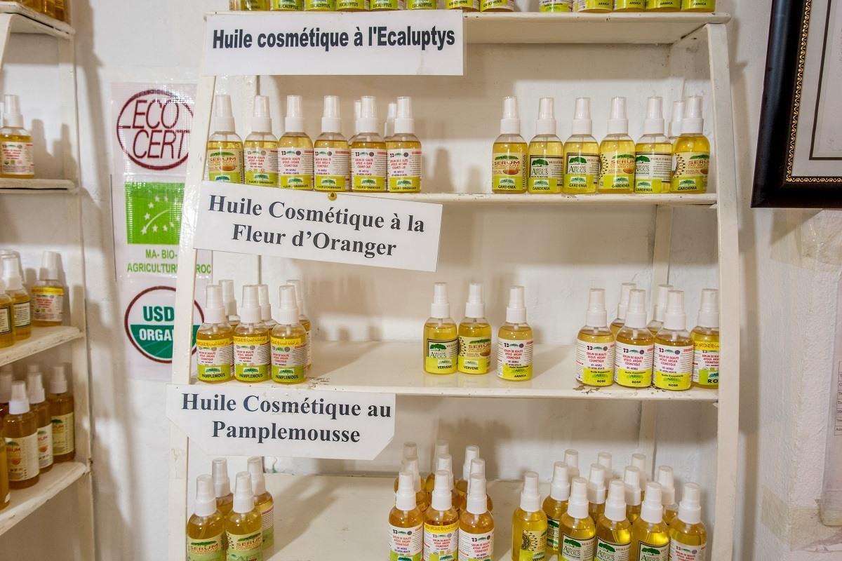 Bottles of argan oil on shelf