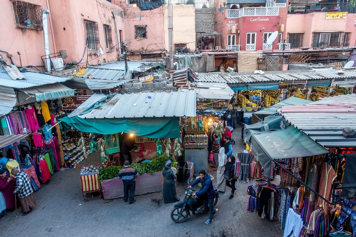 Vendors and shoppers in the street of the medina