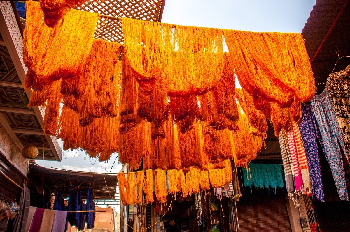 Colored yarn hanging above the dyers' stalls