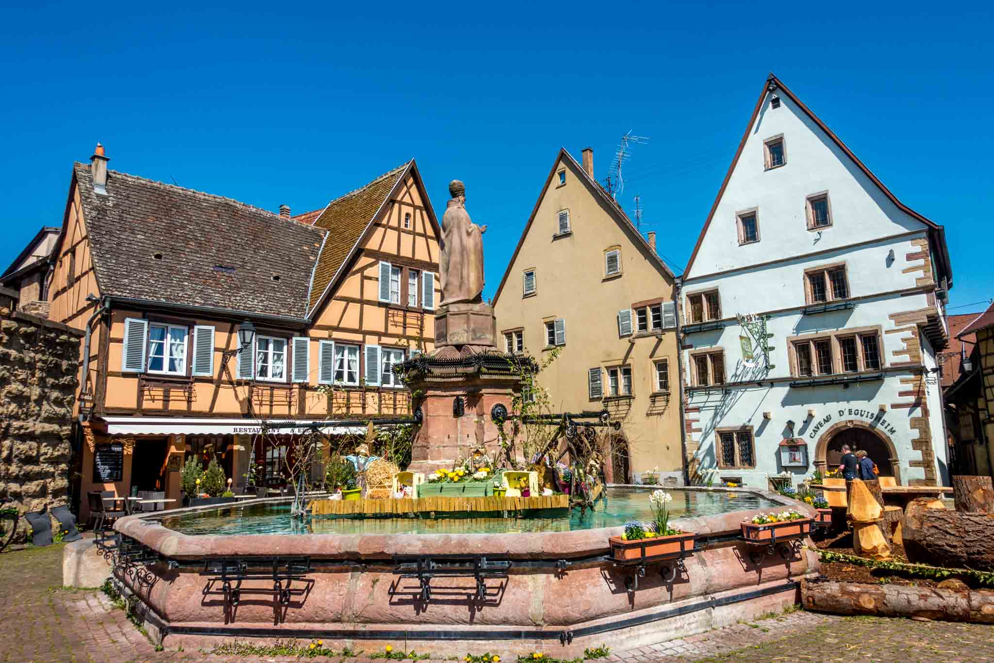Fountain and buildings in Eguisheim town square on the Alsace wine route