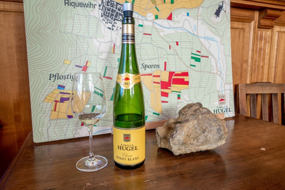 Wine glass and bottle at Alsace winery Hugel