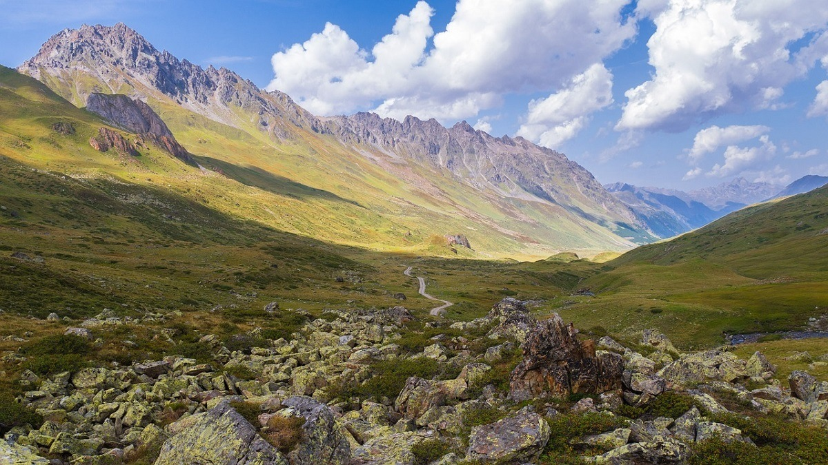 A trail in a green mountain valley