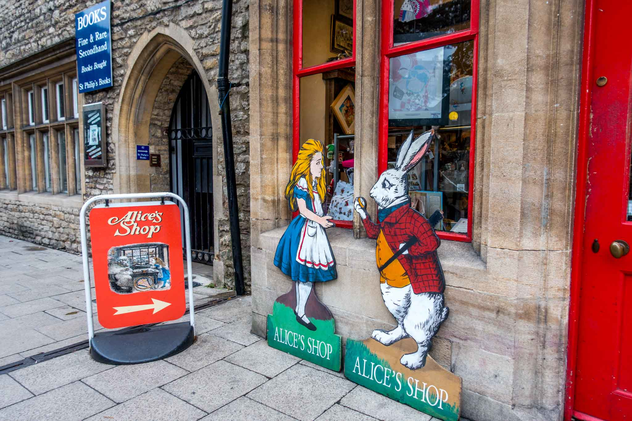 Signs for Alice's Shop including a girl and a rabbit