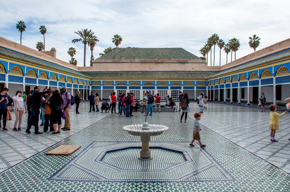 People in a tiled courtyard of a building