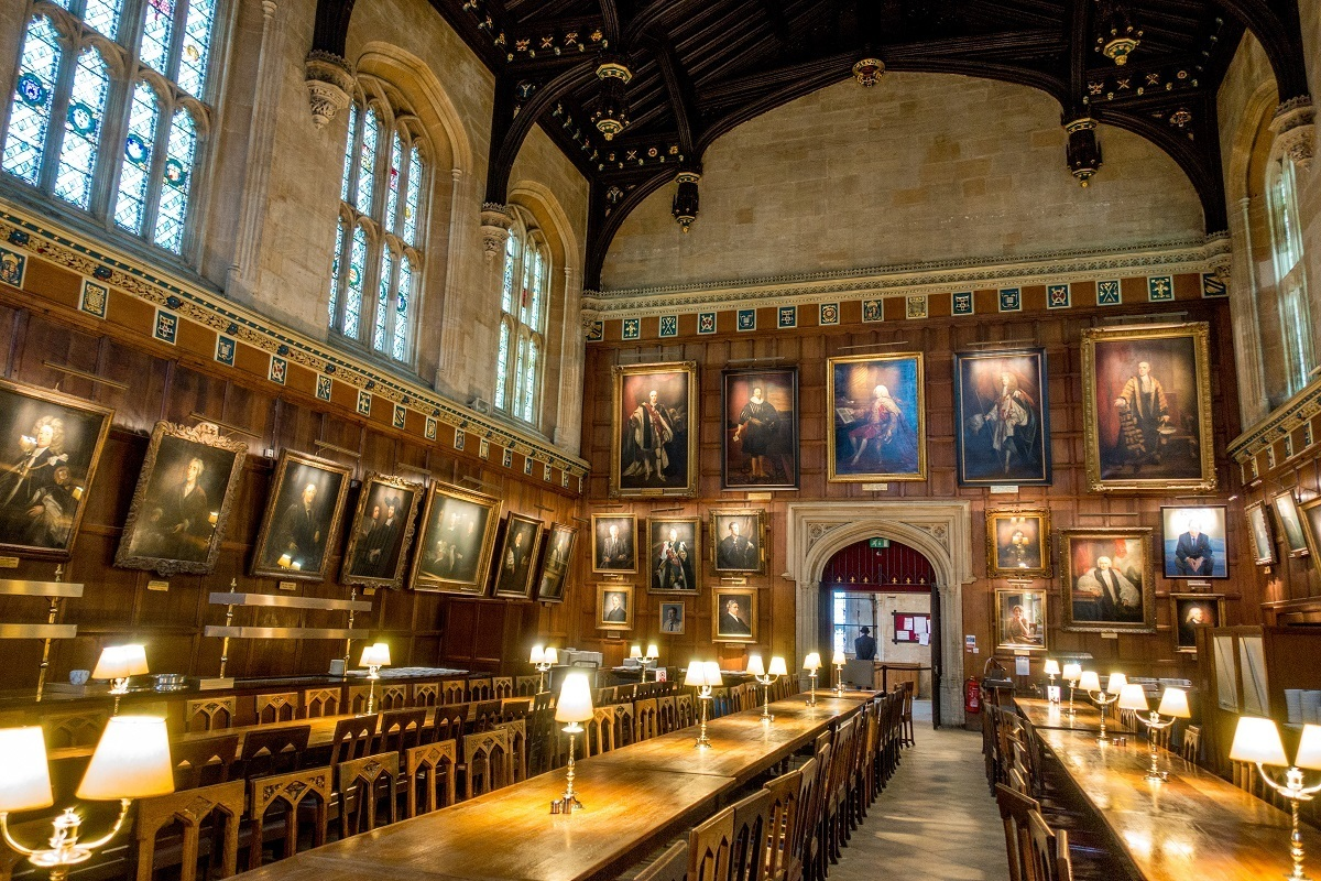 Dining hall with walls lined with portraits