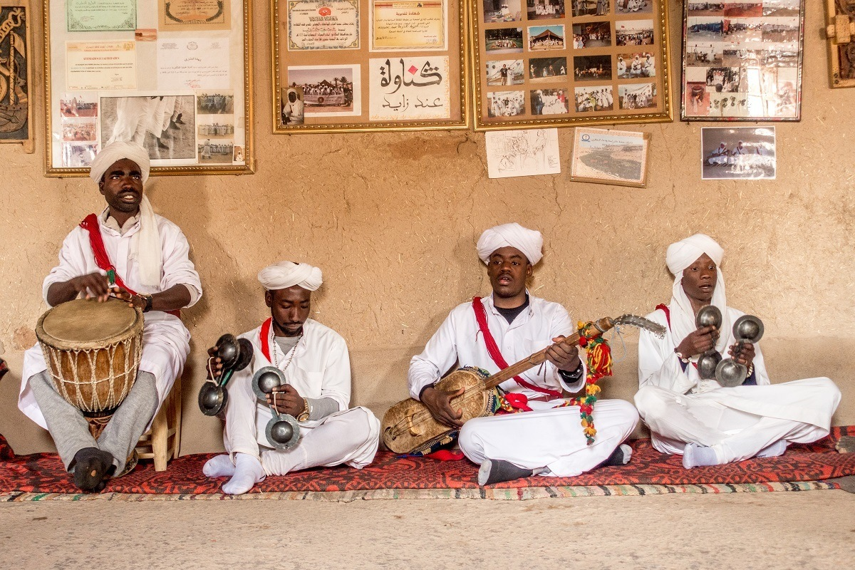 Seated Gnawa musicians performing