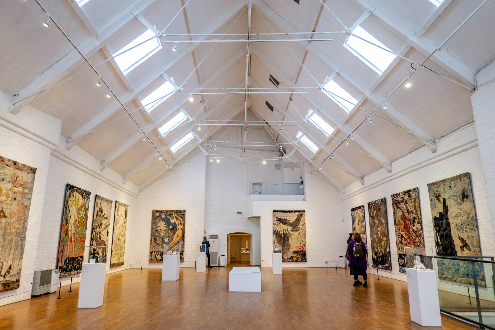 Large art gallery room with paintings on the walls