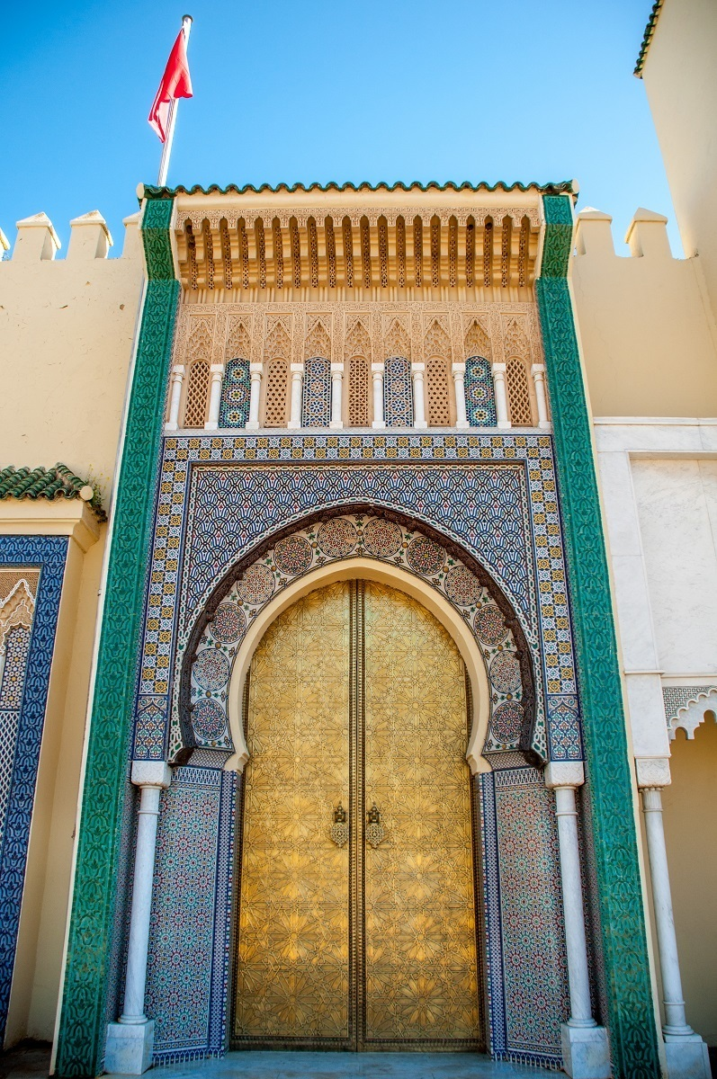 Golden and tiled palace gates