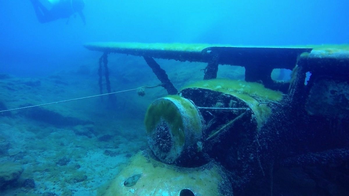Scuba diver with submerged airplane at Dutch Springs near Bethlehem