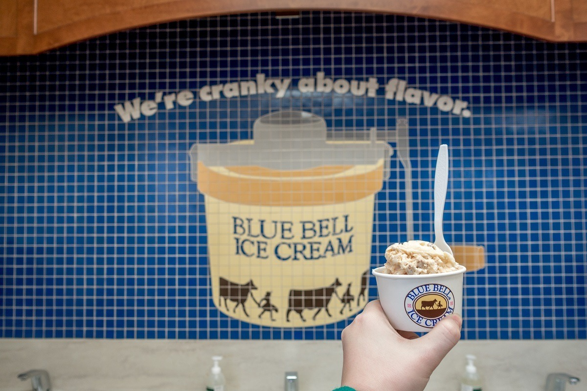 Ice cream cup in front of mosaic at Blue Bell ice cream factory