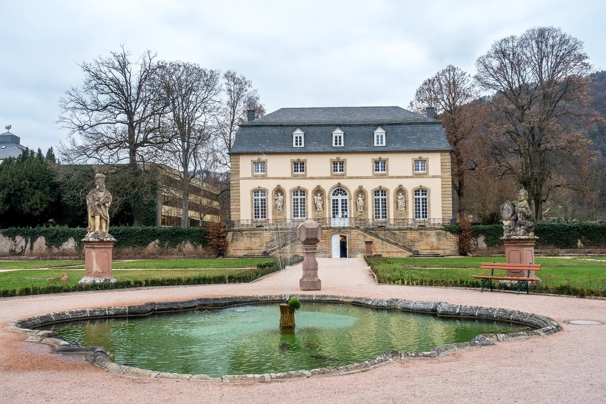 White building and pond, the Orangerie at Echternach Abbey in Luxembourg