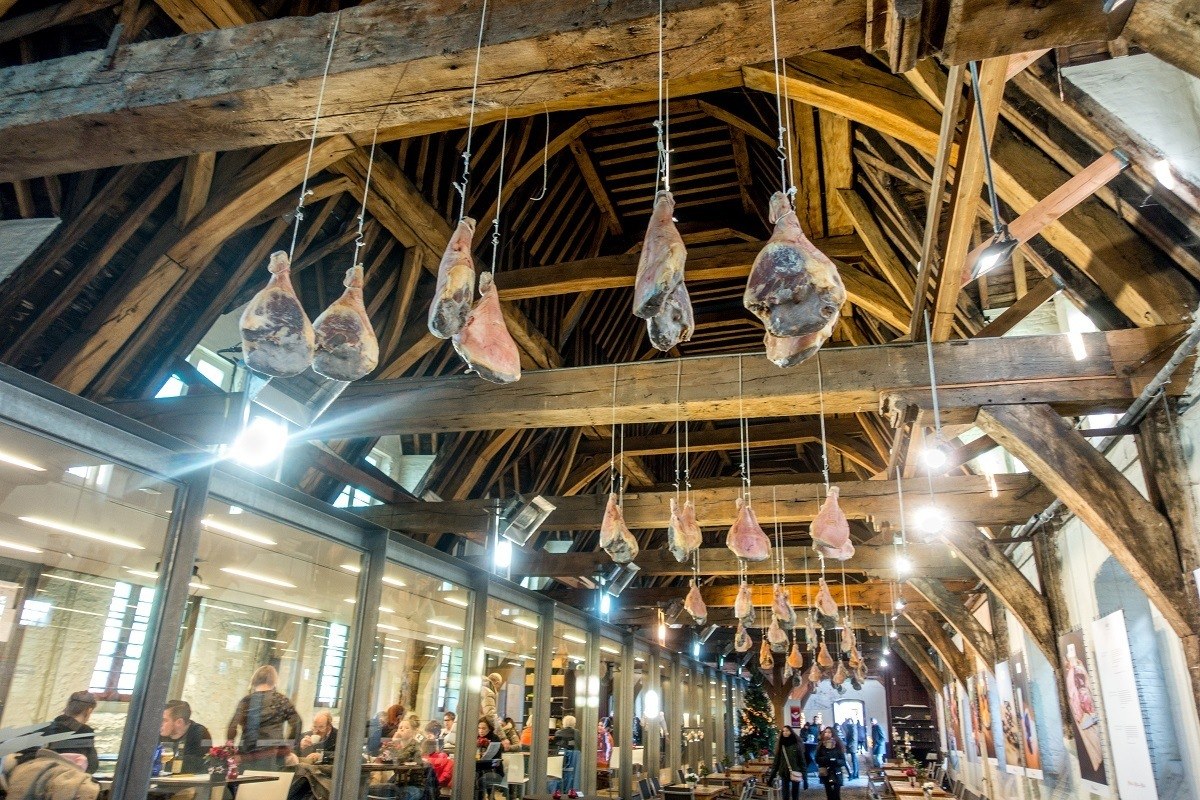 Interior of Butchers' Hall with hams hanging from ceiling