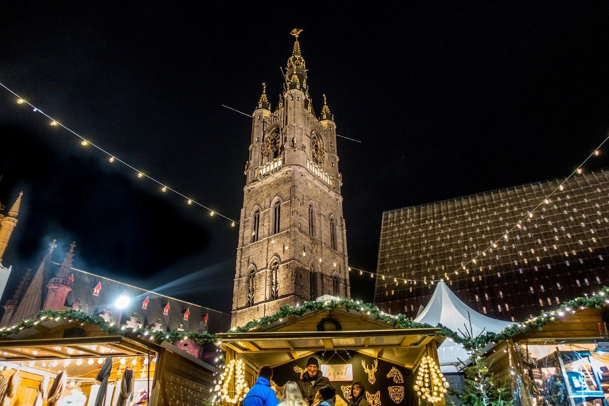Christmas market stalls outside a church at night