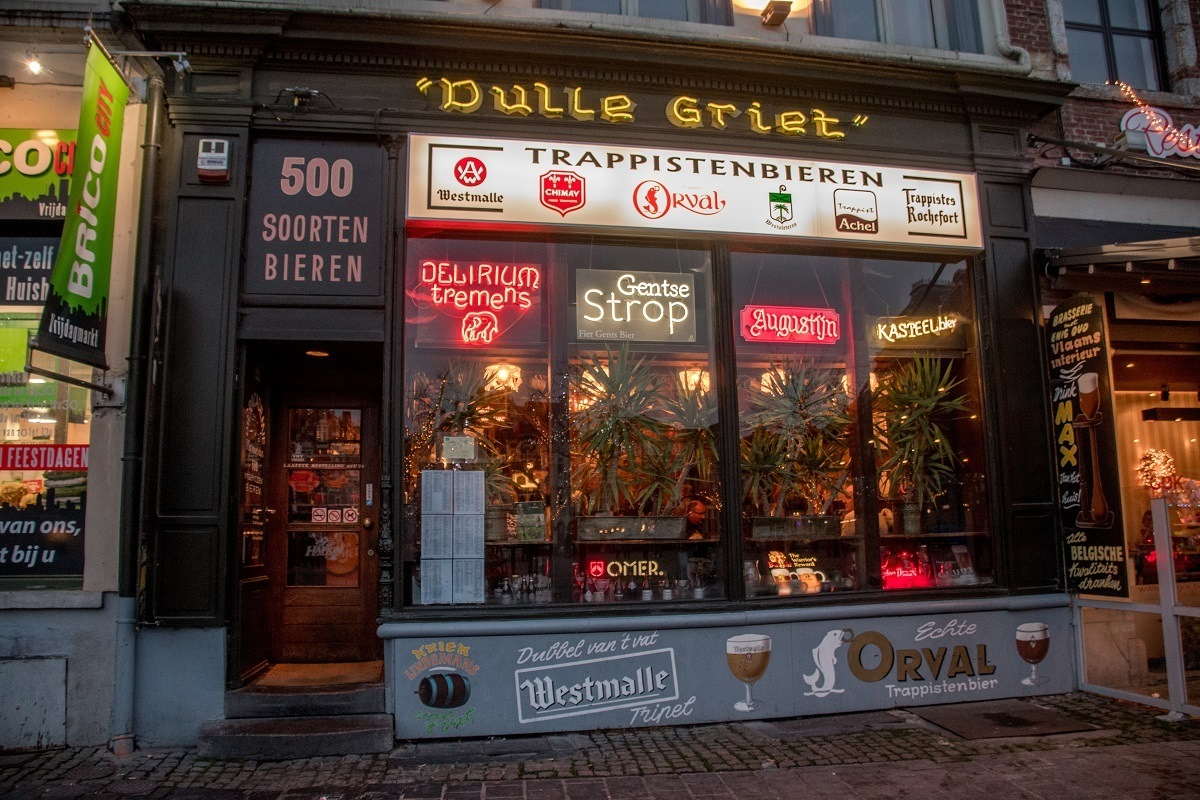 Exterior of bar Dulle Griet with neon signs