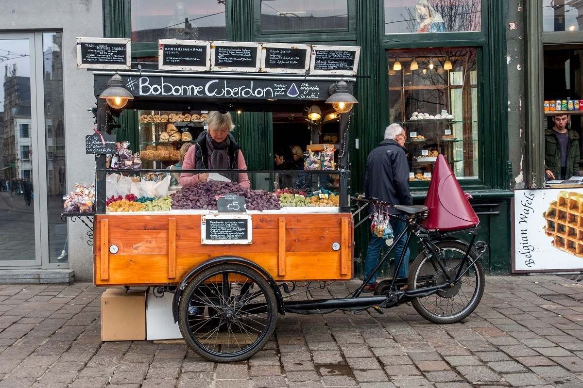 Bicycle cart selling traditional cuberdon candy at the Groentenmarkt