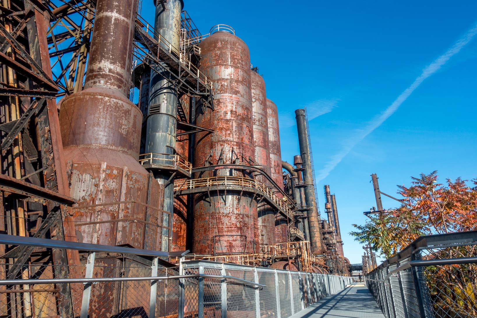 Walkway lined with steel stacks