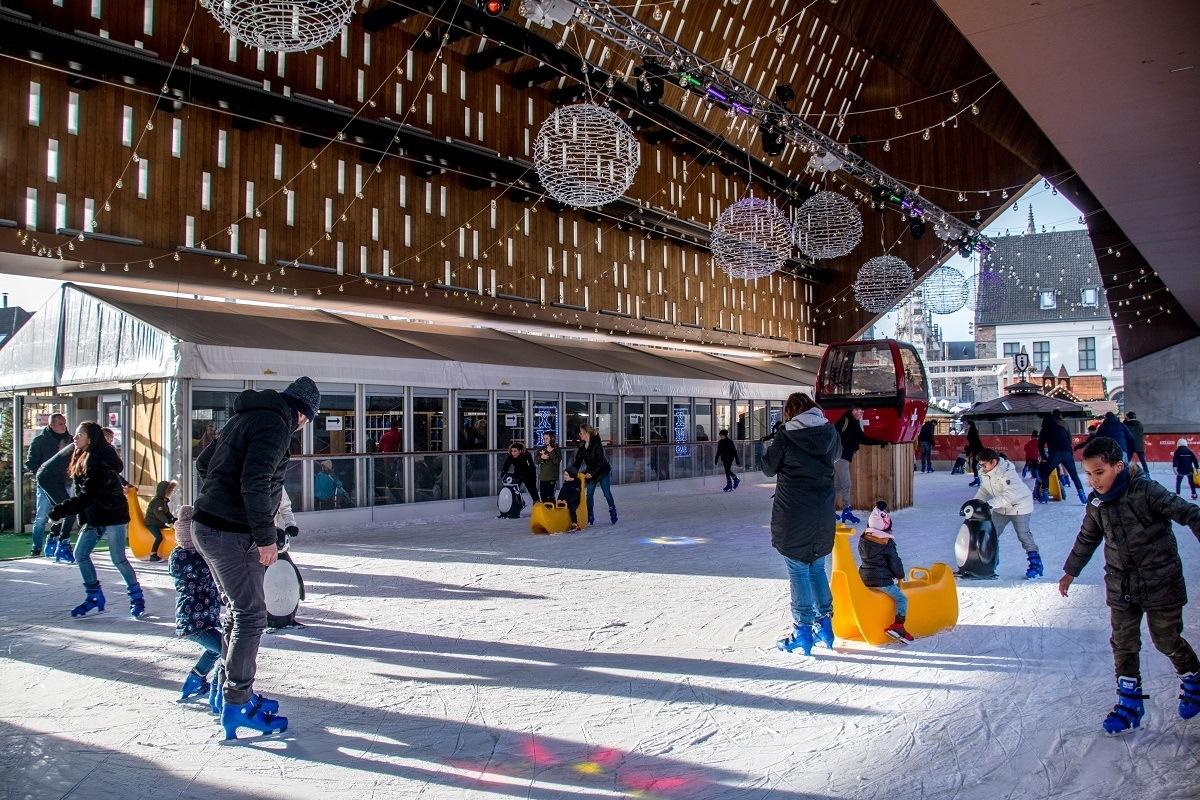 People skating on ice rink