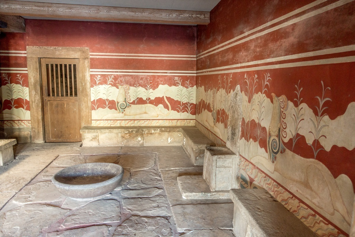 Room with red walls and a stone chair