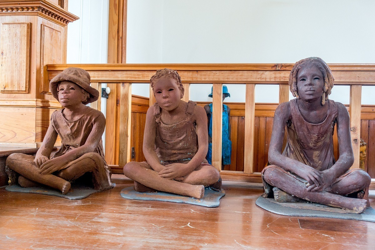 Clay statues representing child slaves