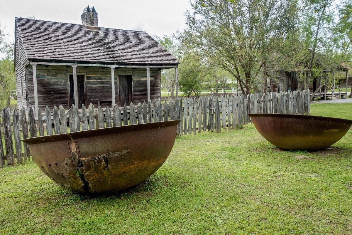 Sugar kettles and former slaves quarters at a New Orleans plantation