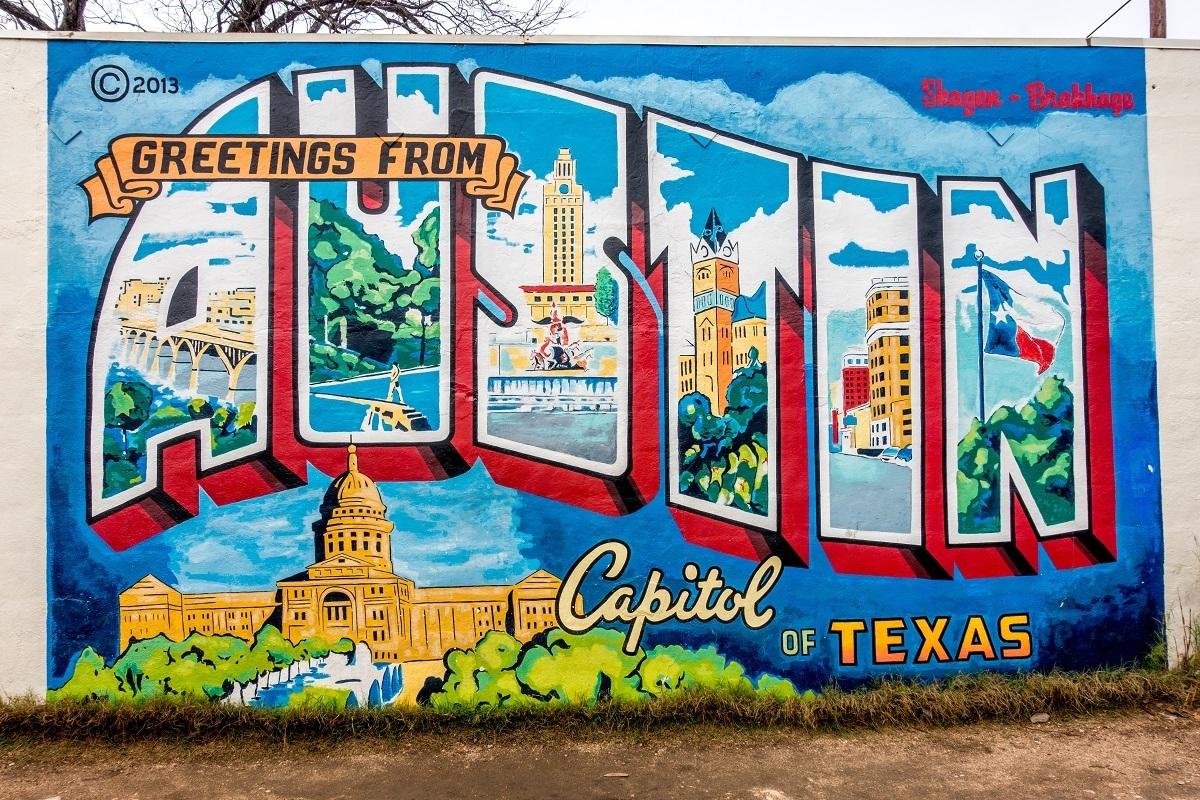 "Colorful street art mural ""Greetings from Austin"""