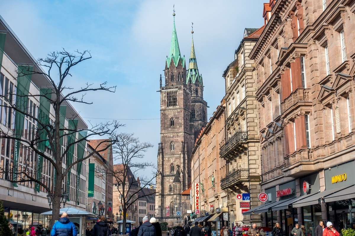 Street lined with stores and a church at the end, Konigstrasse