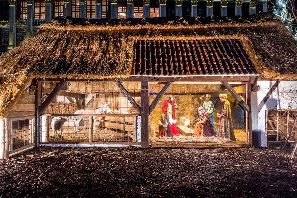 Nativity scene with people and animals in a barn