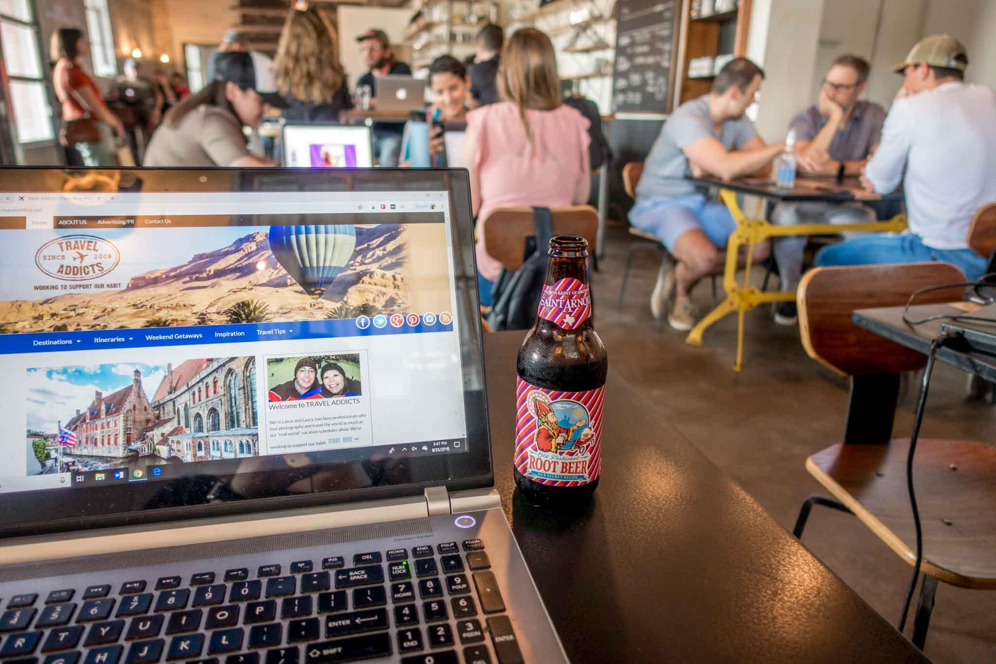 Travel Addicts blog on laptop