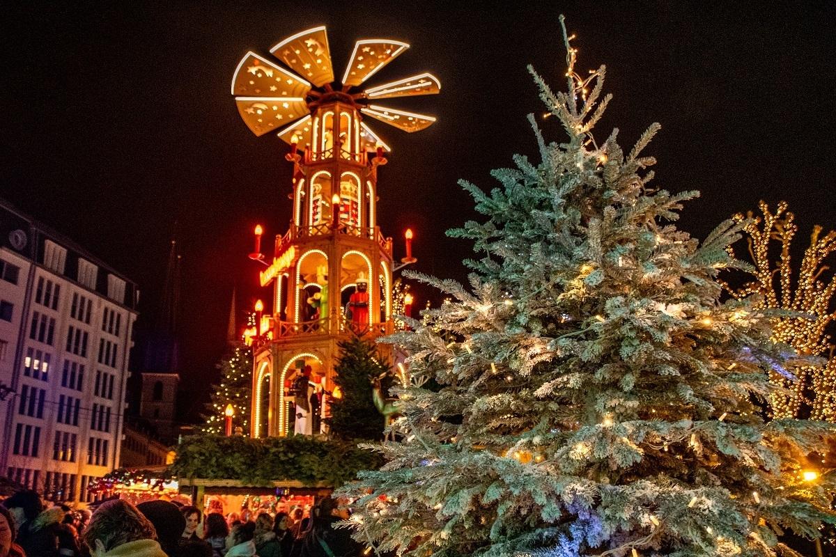 Christmas trees and Christmas pyramid lit up at night