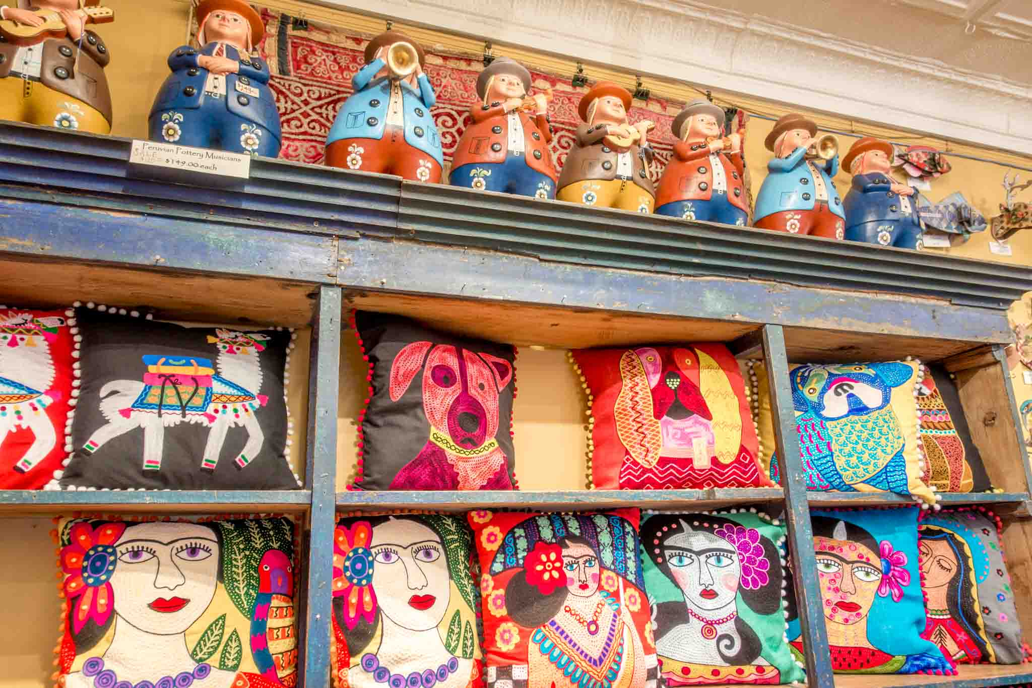 Pillows and musician statues for sale in store